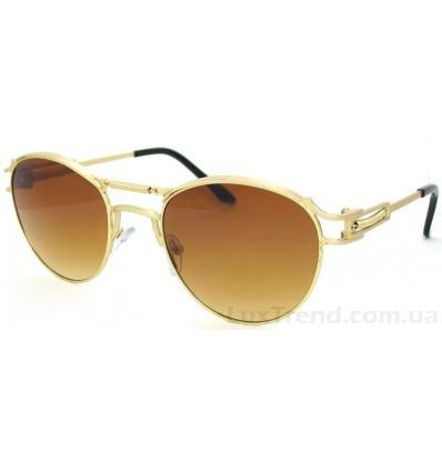 Солнцезащитные очки 8638 овальные золото / коричневые